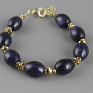 Χειροποίητο βραχιόλι και Δώρο σκουλαρίκια σε ασήμι 925 με κίτρινο επιχρύσωμα στα 14Κ με μπλε χρυσόλιθο και επιχρυσωμένους Αιματίτες στα 165.00ct (ΚΩΔ 1034ST)